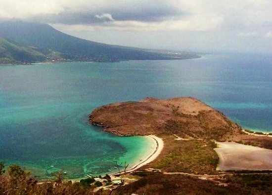 Turtle Beach and reefs from mountain above, Nevis in backgroung.