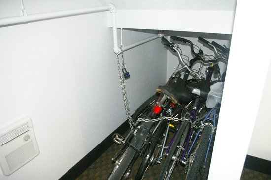 Comfort Inn Traverse City: bicycles in unused space under entry stairs
