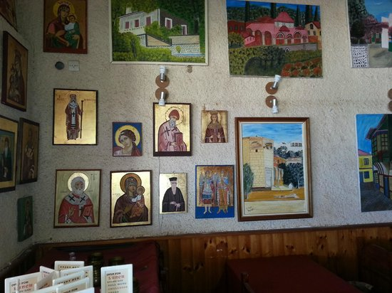 Plomari, Греция: Hand drawn iconography made by the owners father inside the restaurant