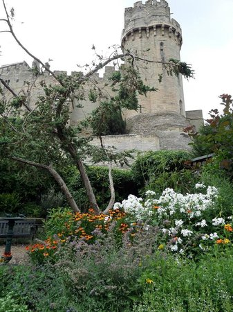 The Mill Garden: View of Warwick castle from the garden bench