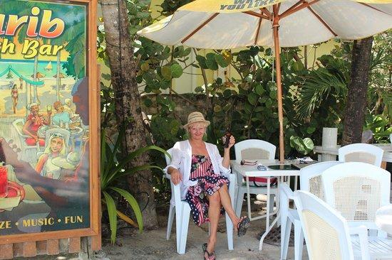 Carib Beach Bar : Paula enjoying a nice cold Banks