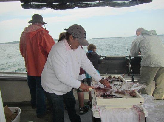Acadia Fishing Tours: Barb filleting fish