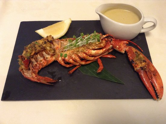Kurries And Steaks: Half lobster marinated and grilled served with Moulee sauce from Kerala