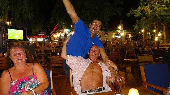 Karbel Beach Hotel: Garden bar on main strip with my Turkish mate the barman