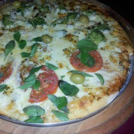 Aromas e Sabores: Pizzaria com forno a lenha.