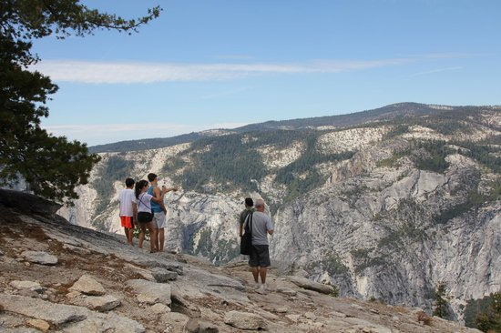 Discover Yosemite: Husband, kids & our guide, Gregg atop Sentinel Dome