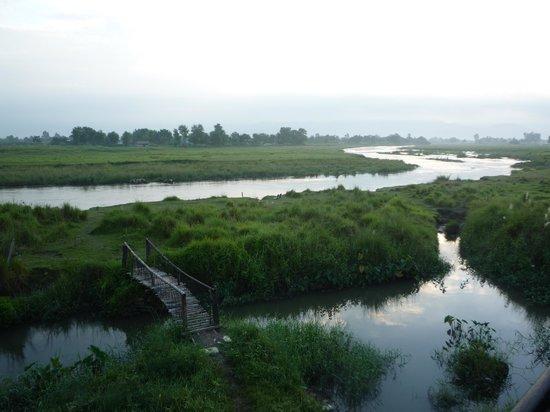 Sapana Village Lodge: ...is a river...