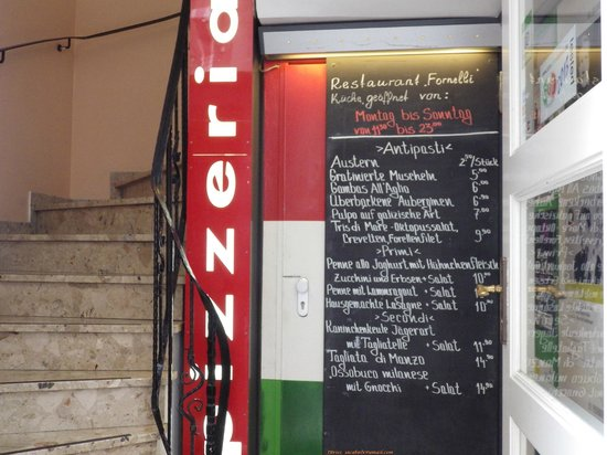 Pizzeria Fornelli: The Menu Specials on ground floor before climbing up to seating