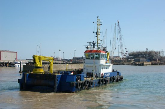 Lowestoft Harbour: A dredger working in the harbour
