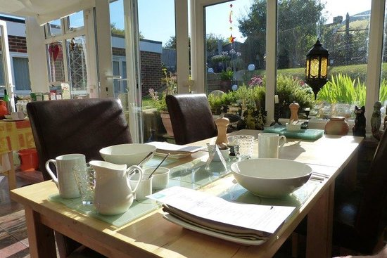 Bishopstone, UK: Breakast table and garden on the background.... thanks to sunny Sussex :)
