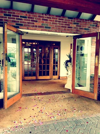 Cottons Hotel & Spa: The hotel entrance, with colourful wedding confetti