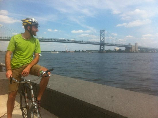 Philly Bike Tour Company: Thom, one of our guides, overlooking the Ben Franklin Bridge from the Race Street Pier