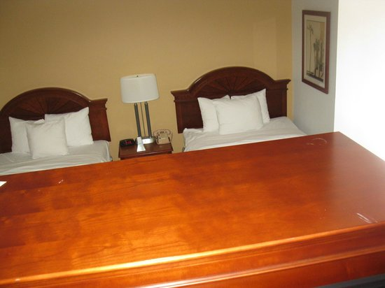 Best Western Port St. Lucie: View from living room looking over entertainment center to beds