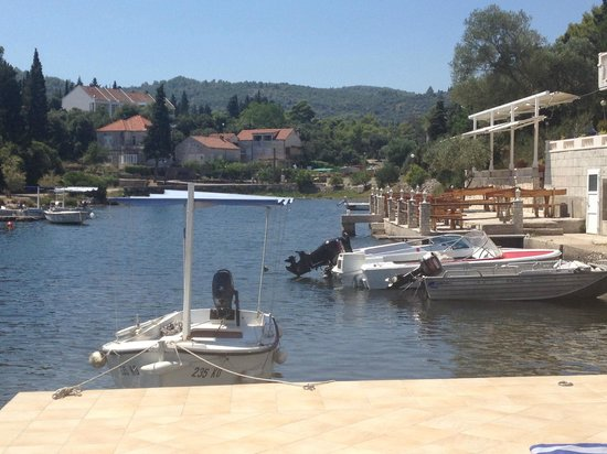 Korcula Waterfront Accommodation: One of the boats you can hire moored to the sun-terrace - complete with sun-canopy