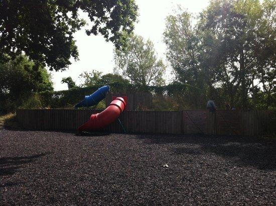 MOO Play Farm: Climbing wall and slides outside