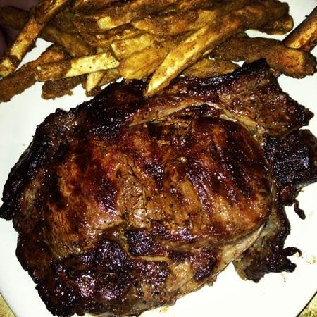 The Village Steakhouse: cowboy steak and fries
