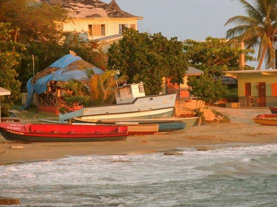 Jakes Hotel Villas Spa Calabash Bay Beach And Fishing Boats
