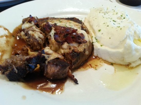 Longhorn Steakhouse : White Cheddar & Bacon Stuffed Steak... don't mind the A1 Sauce --- this one was cooked perfect.