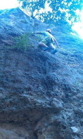 Rock-About Climbing Adventures: Guide Adam setting up 3rd climb