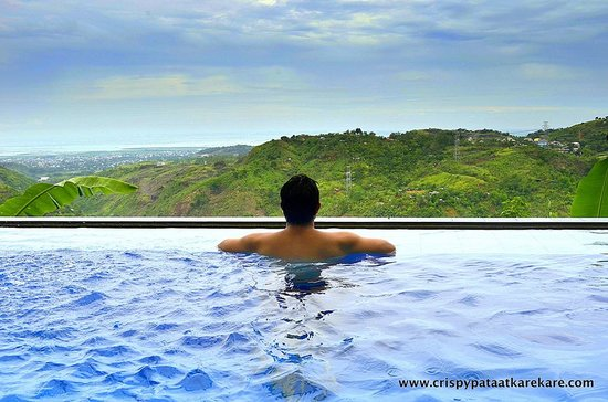Antipolo City, Philippines : Infinity pool overlooking Antipolo mountains, Laguna De Bay and Metro Manila