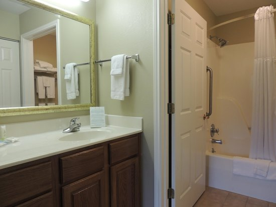 Staybridge Suites Corning: Vanity/sink next to room with toilet and bath