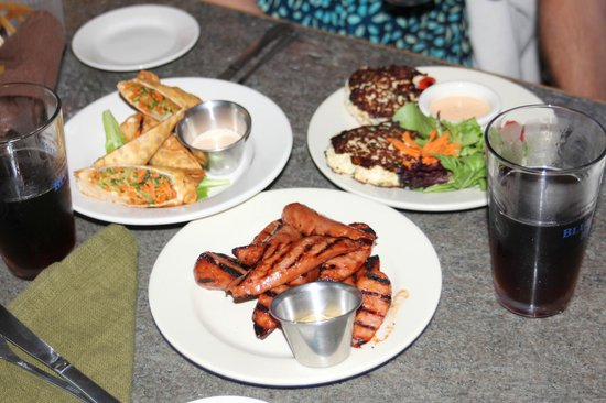 Blue Paddle Bistro: 3 delicious appetizers: Veggie Spring Rolls, barbecued Kielbasa, and Crab Cakes.