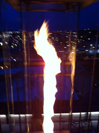 Hotel Alex Johnson Rapid City, Curio Collection by Hilton : flaming toch light on the rooftop restaurant