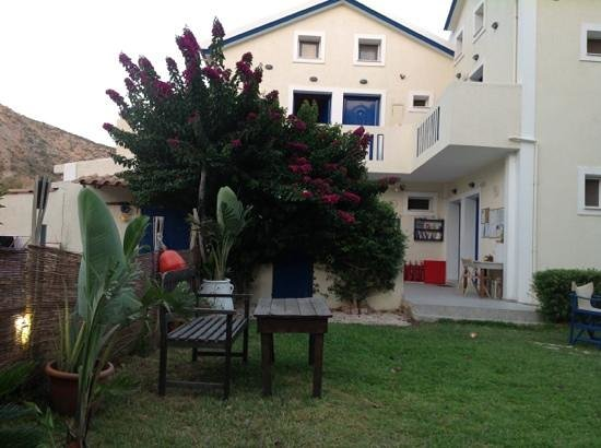 Dreams Beach Apartments Katelios: side of the garden with noticeboard and local information...