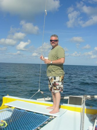 Hat Trick Charters : Happy with a rum swizzle