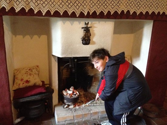 Cloch na Scith Thatched Cottage: theh finishing touch - bread into the peat fire