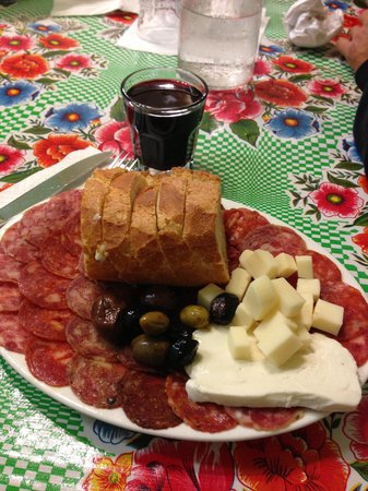 Armandino's Salumi: The Salami Sampler with cheese and olives