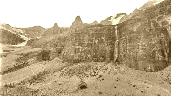 Stanley Glacier Hike : The falls and upper cliffs - in Sepia