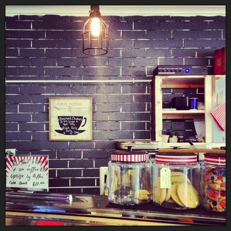 Benchtop Espresso: Love the sparsly painted brick wall and old light