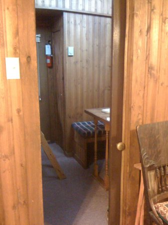 Train Station Inn: Caboose 4: Pocket door separates bunk beds from main bedroom area