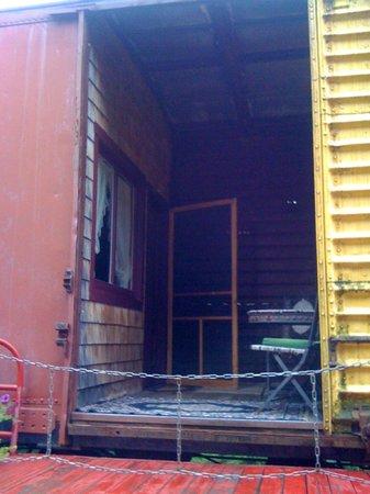 Train Station Inn: Balacony area between rooms in a box car