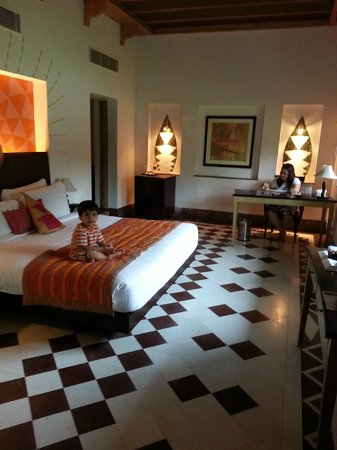 Ramada Udaipur Resort and Spa: my sweetu relaxing in the cozy bed