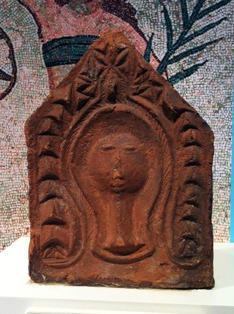 Yorkshire Museum: Protective deity in a roof tile