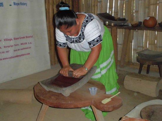 Maya Center Mayan Museum: Heliadora Saqui, demenstrating chocolate making at the Mayan Museum. You will get otdo this.