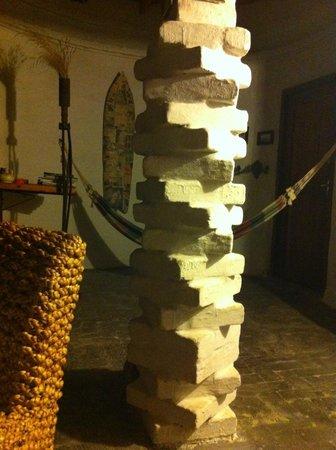 Alternative Space B & B: creative design of a pillar in livingroom
