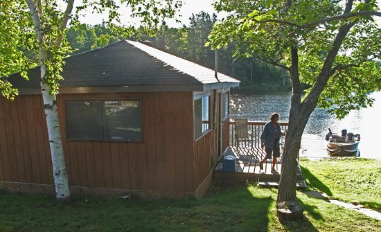 Waterfalls Lodge: The Cabin, boat and dock