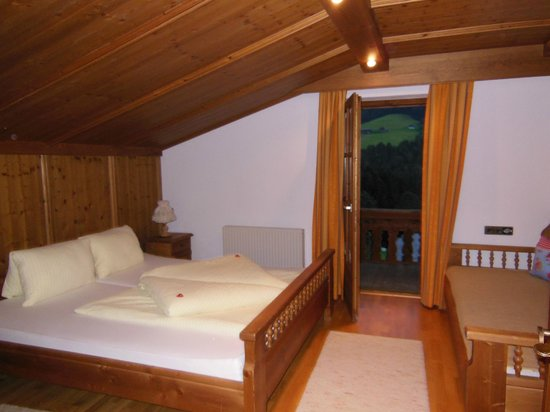 Appartementhaus Hubertus: master bedroom with door to balcony- extra couch for sleeping- full bath and TONS of storage