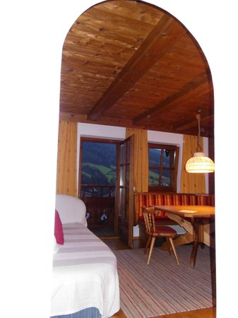 Appartementhaus Hubertus: dining and sitting room with large flat screen and door to balcony