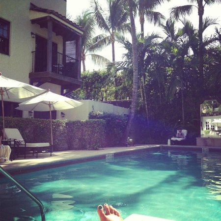 The Brazilian Court Hotel Lounging By Pool At Paradise