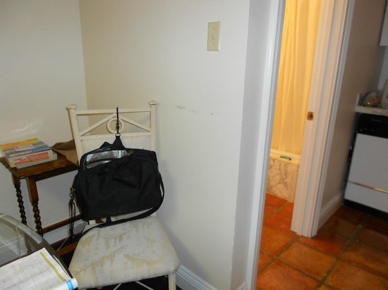 Hotel de L'Eau Vive: dining table between bathroom and kitchen - had to put toiletries on dining room chairs and tabl
