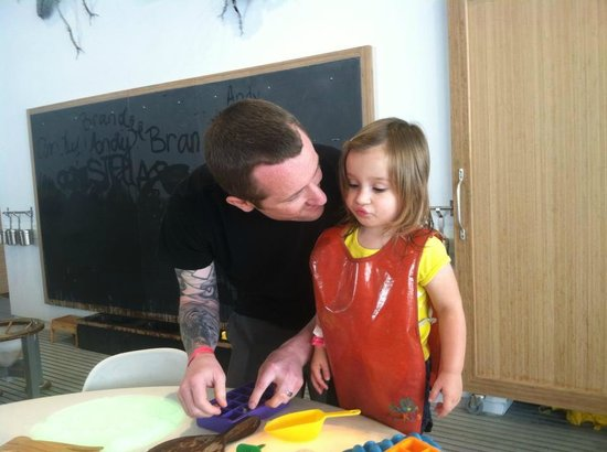 Children's Museum of Pittsburgh : My husband and daughter enjoying playing with ice!