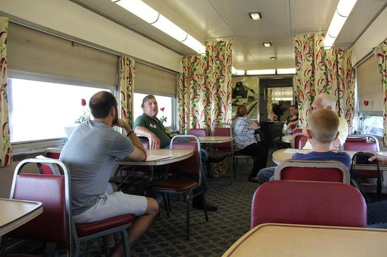 Historic Railpark and Train Museum: Museum tour guide Ed Schwab (with badge) talks about the dining car.