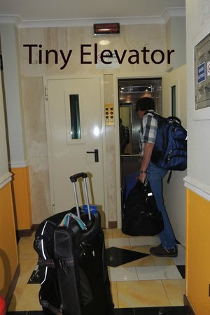 Hotel Executive: tiny elevator - two people, two suitcases