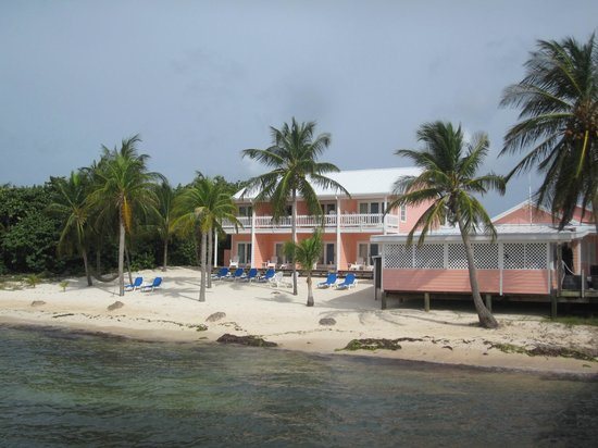 Little Cayman Beach Resort: Beach area, oceanfront rooms, and dive shed.