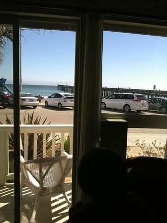 On The Beach Bed & Breakfast: Looking out the sliding door to our private little terrace, beach steps away