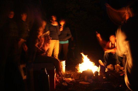 Wanderlust Tours: Bonfire on bank of Elk lake under starlight